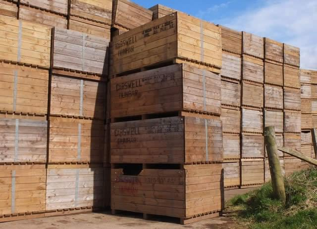 a big stack of boxes or crates sat on top of one another