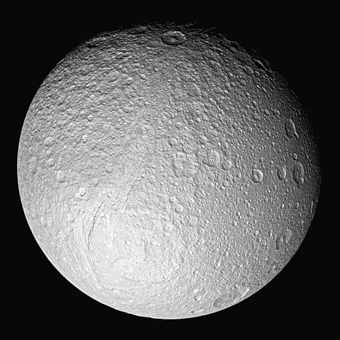 Saturn's fifth-largest moon, Tethys, is lit primarily by the sun, with some light reflected from Saturn. This is diffuse lighting.